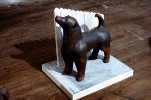 "German Shepherd  1984 23"" x 20.5 x 18""  clay dog sculpture on painted wood base"